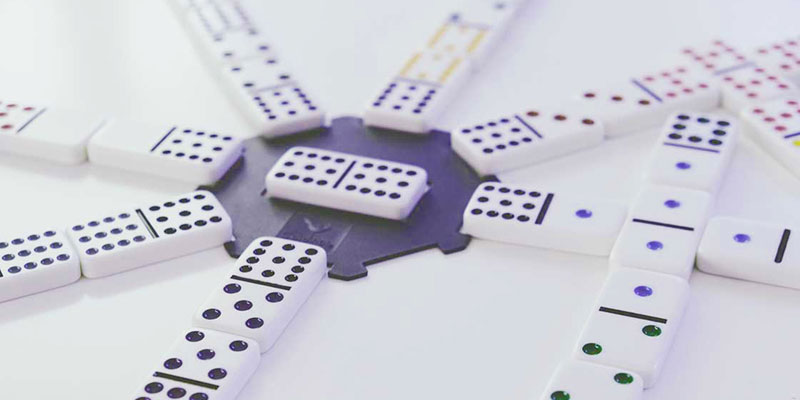 a series of dominos all connected to a central point signaling automation