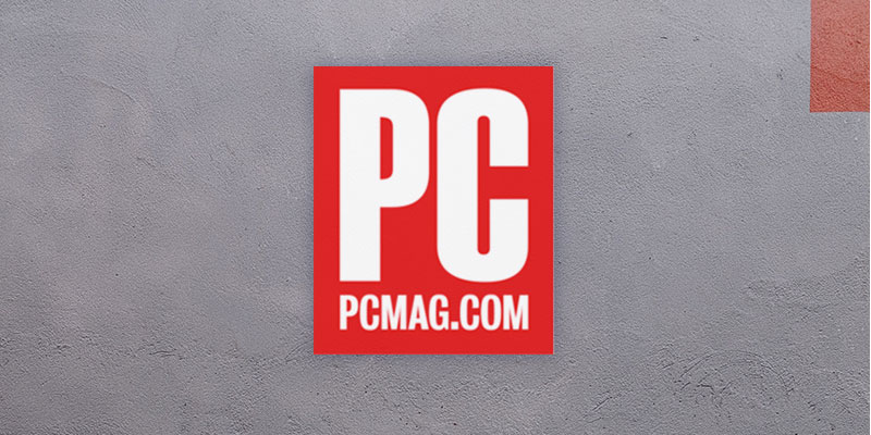a red and white pc mag logo on a grey distressed background
