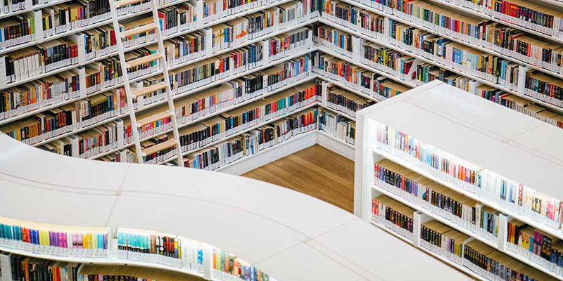 a birds eye view of clean modern white bookshelves and catalogue