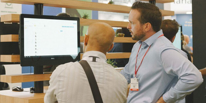 IT manager providing a service management software demo to a prospective customer